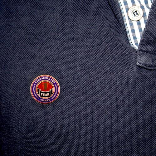 Geo Award Geocoin - 1 Jahr Pin angesteckt
